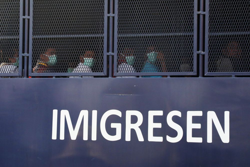 Myanmar migrants to be deported from Malaysia are seen inside an immigration truck, in Lumut February 23, 2021. — Reuters pic