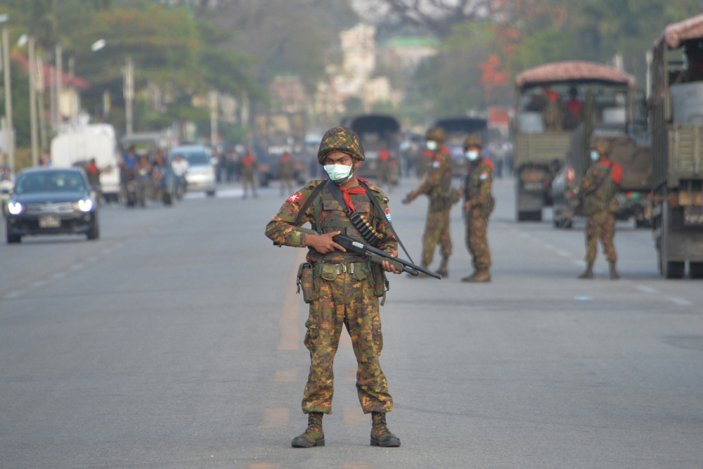 A Myanmar soldier stands guard on a road amid demonstrations against the military coup in Naypyidaw February 17, 2021. — AFP pic