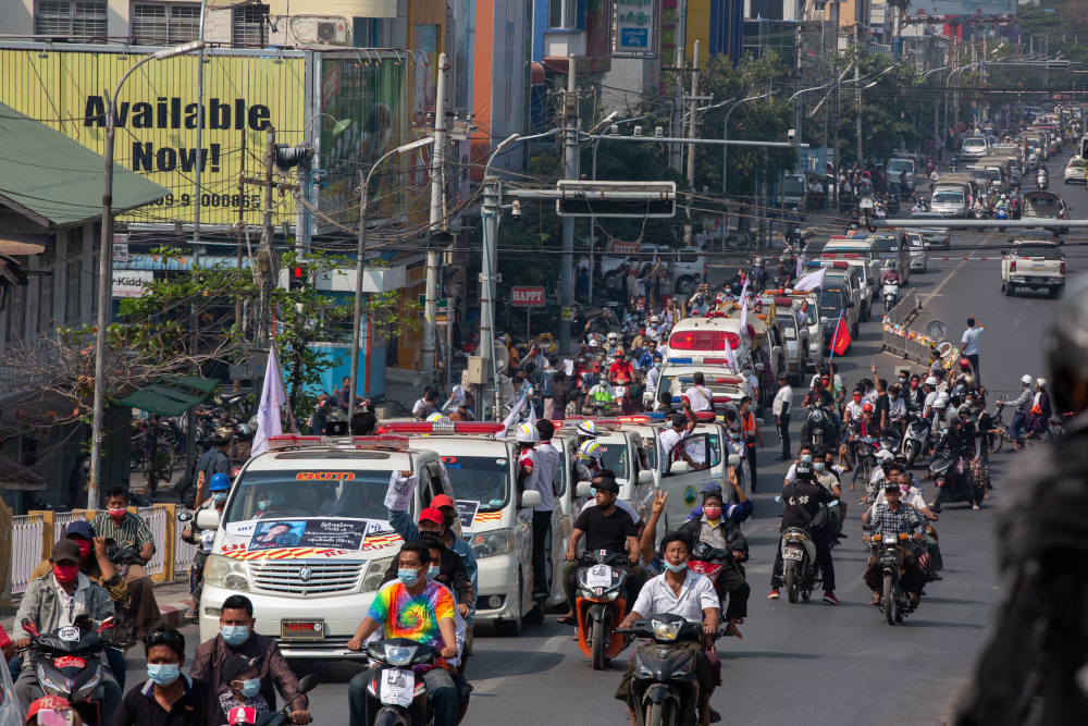 A convoy of cars makes its way during the funeral for protester Thet Naing Win, who died from a gunshot wound while taking part in a demonstration against the military coup last week, in Mandalay February 23, 2021. — AFP pic
