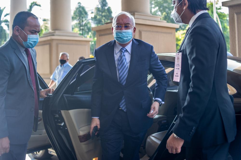 Datuk Seri Najib Razak arrives at the Kuala Lumpur High Court February 15, 2021. — Picture by Shafwan Zaidon