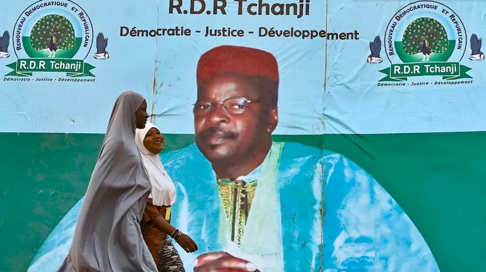 A giant poster for Mahamane Ousmane, who is contesting former interior minister Mohamed Bazoum in Sunday's runoff. — AFP pic