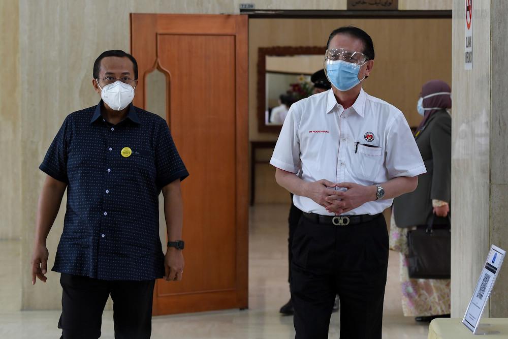 Health Director-General Tan Sri Dr Noor Hisham Abdullah with Datuk Seri Ahmad Samsuri Mokhtar (left) during a working visit to Terengganu at Wisma Darul Iman February 1, 2021. — Bernama pic
