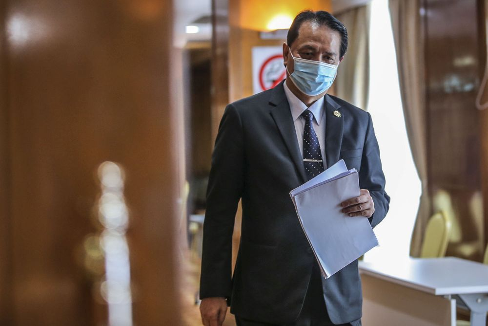 Health director-general Tan Sri Dr Noor Hisham Abdullah arrives for his daily press conference on Covid-19 in Putrajaya February 9, 2020. — Picture by Hari Anggara