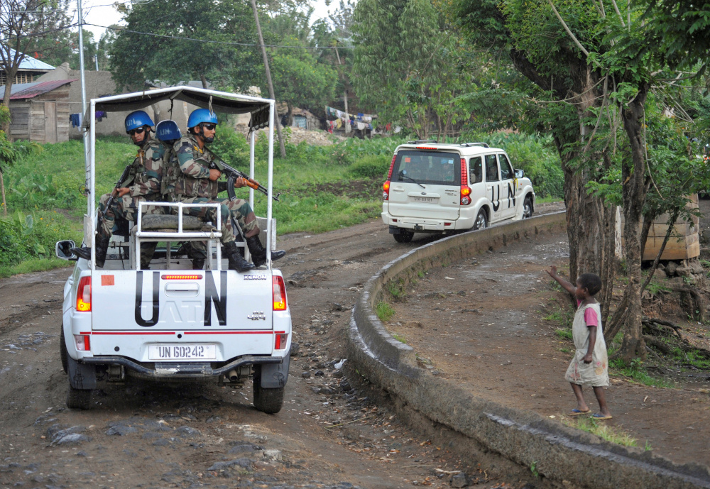 A Congolese girl gestures to peacekeepers from India, serving in the UN Organisation Stabilisation Mission in the Democratic Republic of the Congo (Monusco), as they ride on patrol in Kiwanja October 19, 2018. — Reuters pic