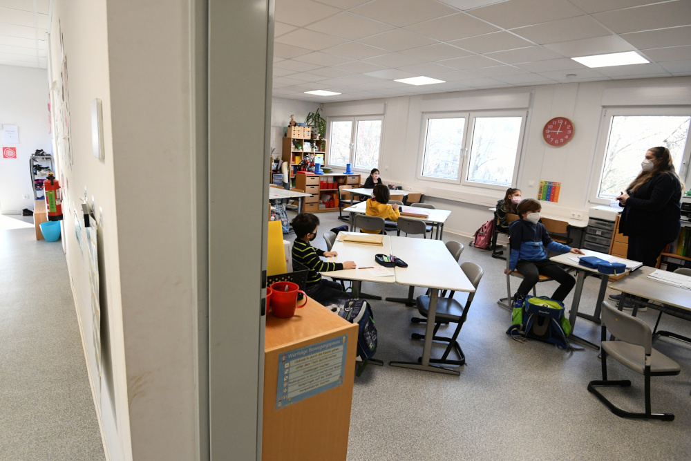 Schoolchildren participate in a lesson at Gustav-Falke elementary school, after it reopened according to first measures to lift the Covid-19 lockdown in Berlin February 22, 2021. — Reuters pic