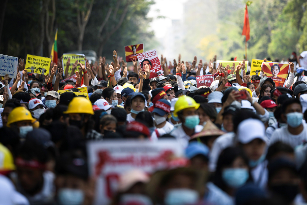Demonstrators flash the three-finger salute as they take part in a protest against the military coup in Yangon February 22, 2021. — Reuters pic