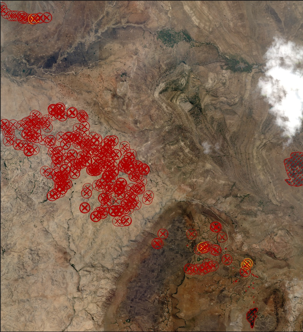 Satellite image of Gijet in Tigray region with marked red crosses relate to number of structures significantly damaged and orange crosses show limited damage, lines to the right identify visible scorching, February 23, 2021. — Picture by Planet Labs Inc