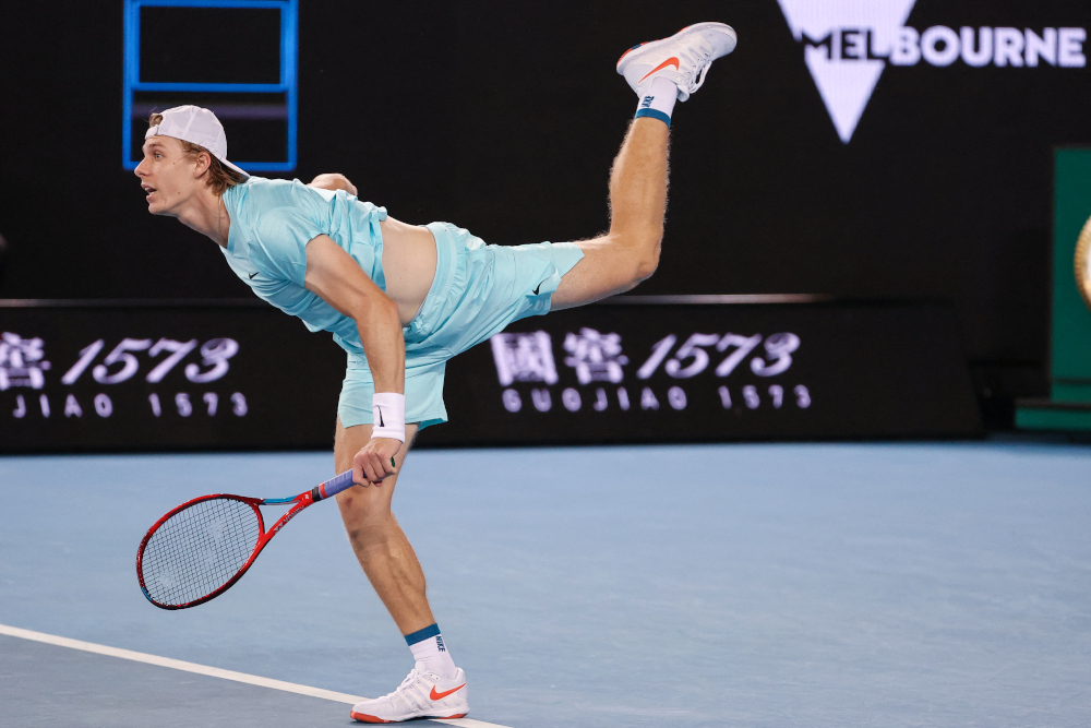 Canada's Denis Shapovalov serves against Italy's Jannik Sinner during their men's singles match on day one of the Australian Open tennis tournament in Melbourne on February 8, 2021. — AFP pic