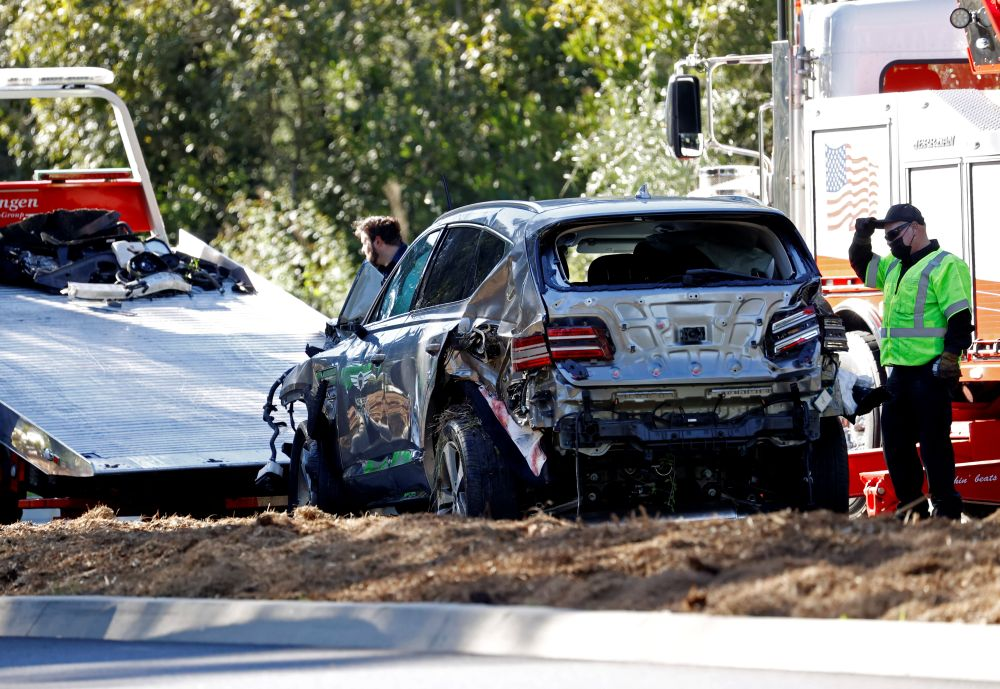 The damaged car of Tiger Woods is towed away after he was involved in a car crash, near Los Angeles, California February 23, 2021. — Reuters pic