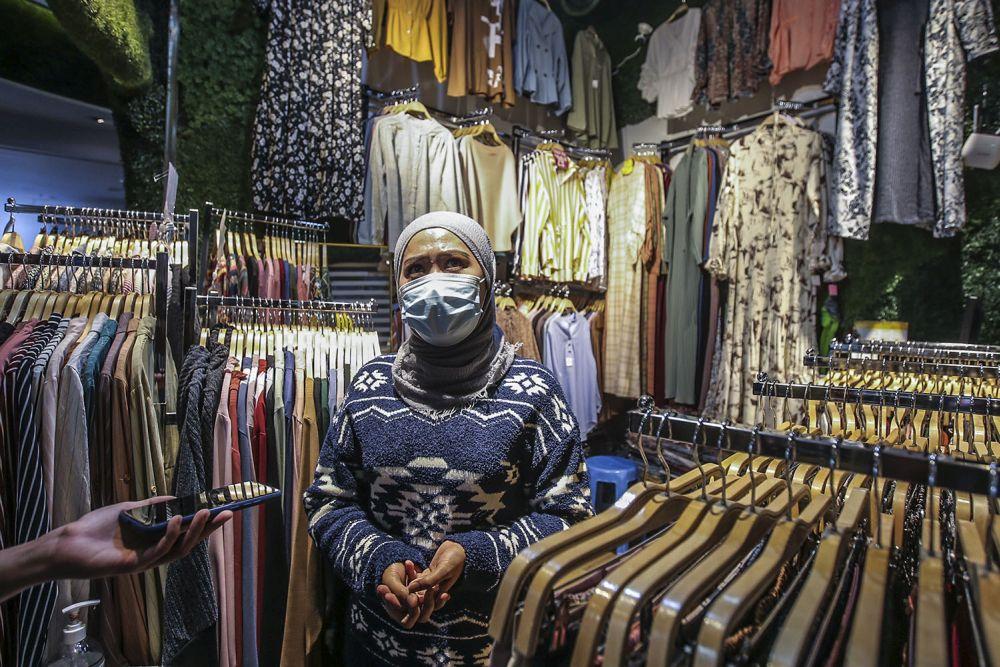Shopkeeper Norhaima Maskito speaks during an interview with Malay Mail at Berjaya Times Square, Kuala Lumpur February 23, 2021. ― Picture by Hari Anggara