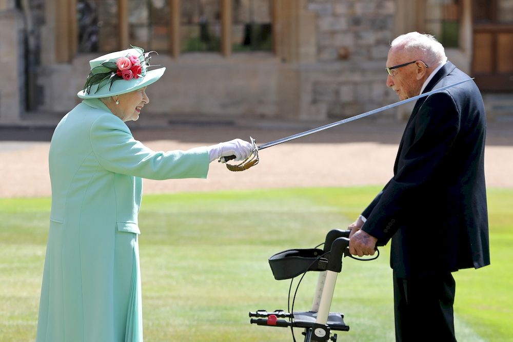 Britain's Queen Elizabeth awards Captain Tom Moore with the insignia of Knight Bachelor at Windsor Castle, in Windsor, Britain July 17, 2020. — Reuters file pic