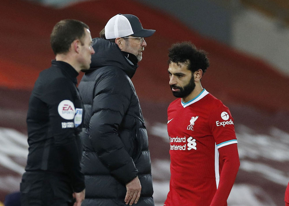 Liverpool's Mohamed Salah walks past manager Juergen Klopp after being substituted off, March 5, 2021. — Pool via Reuters/Phil Noble