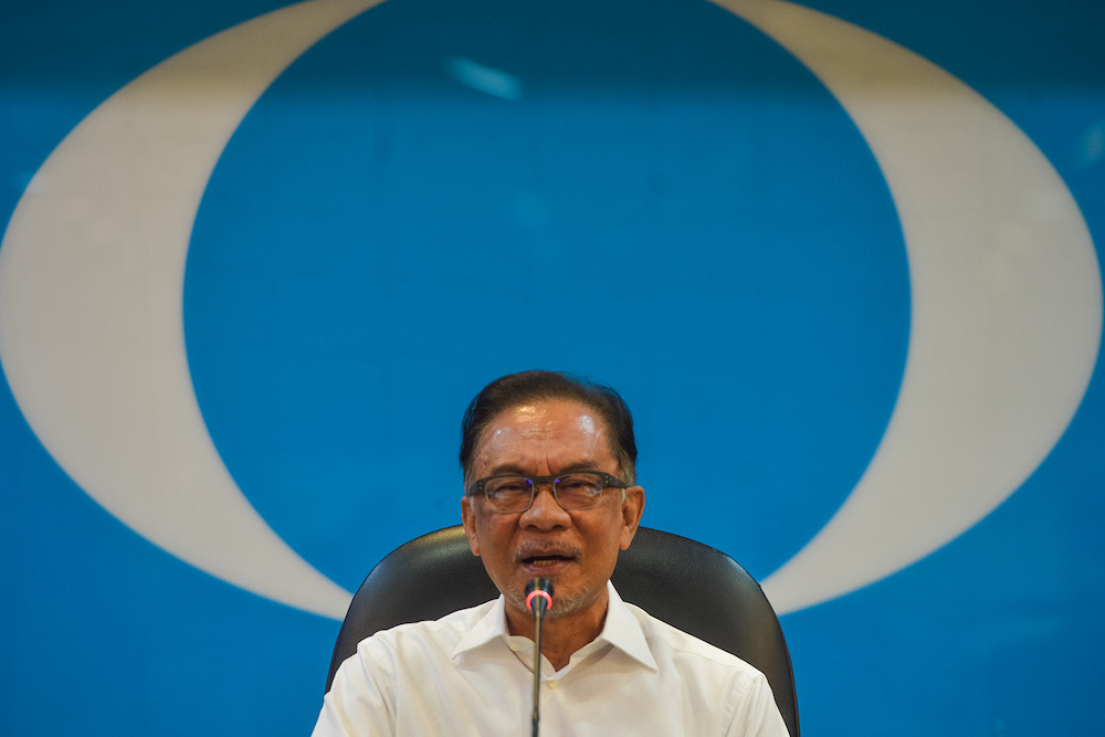 PKR president Datuk Seri Anwar Ibrahim warned the Perikatan Nasional government that rising personal debt among Malaysians, especially those taken to buy homes and vehicles, will derail post Covid-19 economic recovery efforts if nothing is done immediately. — Picture by Miera Zulyana