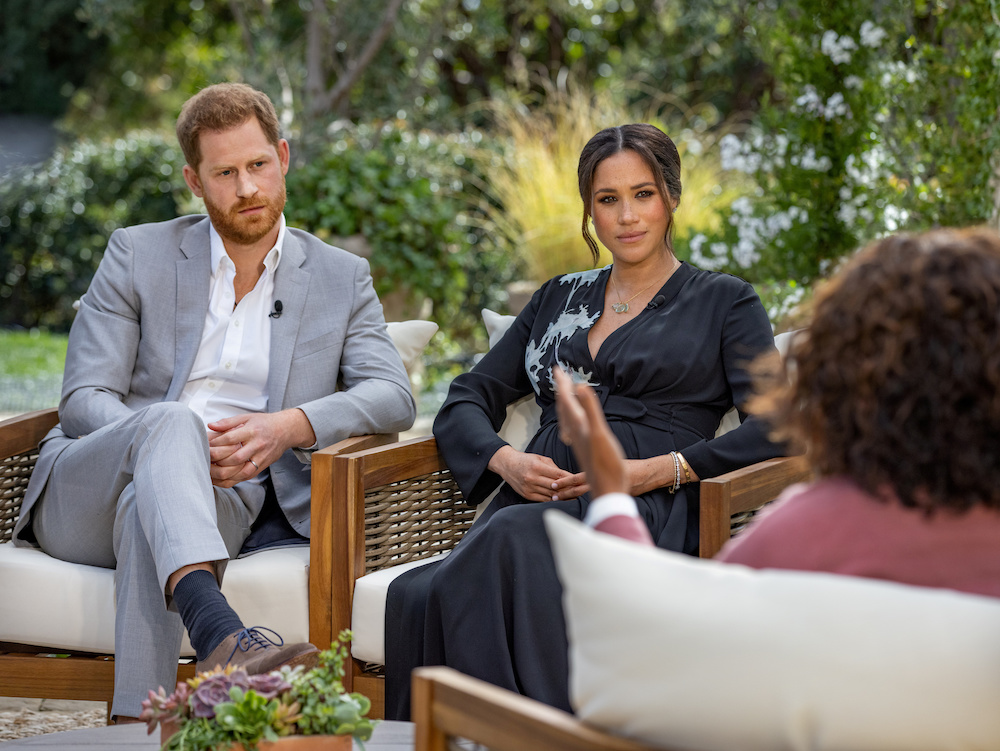 Britain's Prince Harry and Meghan, Duchess of Sussex, are interviewed by Oprah Winfrey in this undated handout photo. — Reuters pic