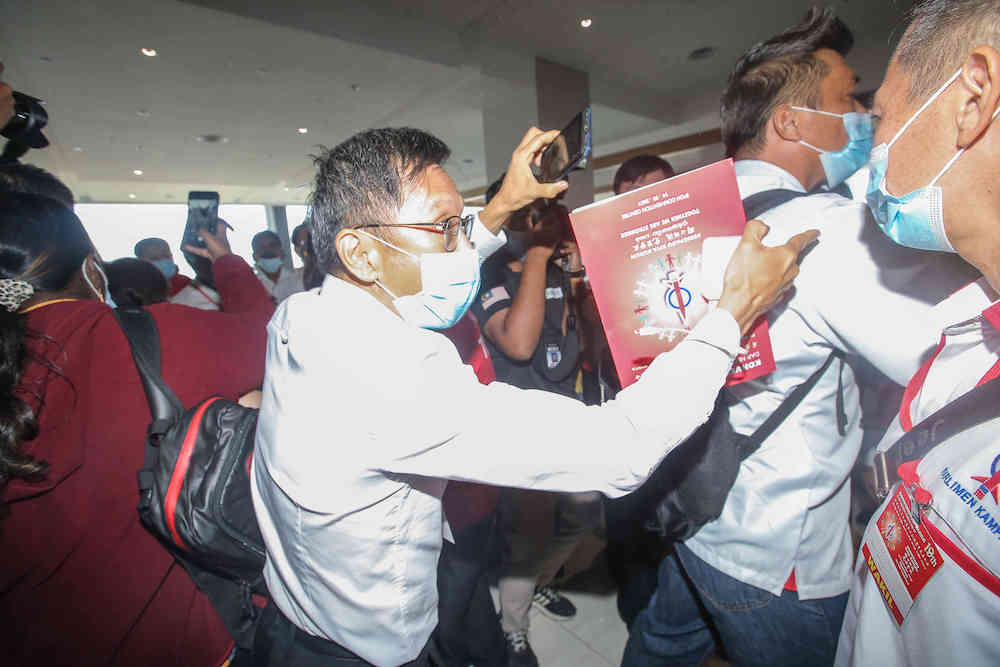 Chaos broke out at the DAP party election today at the Ipoh Convention Centre over alleged unfairness in the registration of delegates, March 14, 2021. — Picture by Farhan Najib