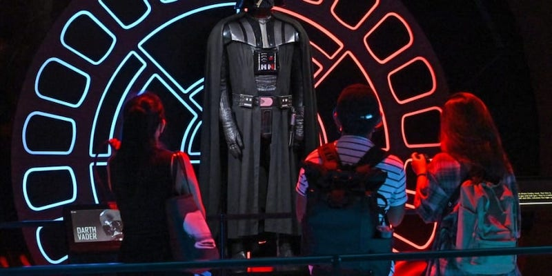 Visitors look at a life-sized figure of the character Darth Vader from the Star Wars series displayed at the Star Wars Identities exhibition at the ArtScience Museum in Singapore January 28, 2021. — AFP pic