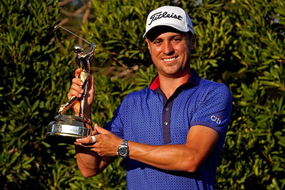Justin Thomas celebrates with the trophy after winning The Players Championship golf tournament, March 14, 2021. — Reuters pic