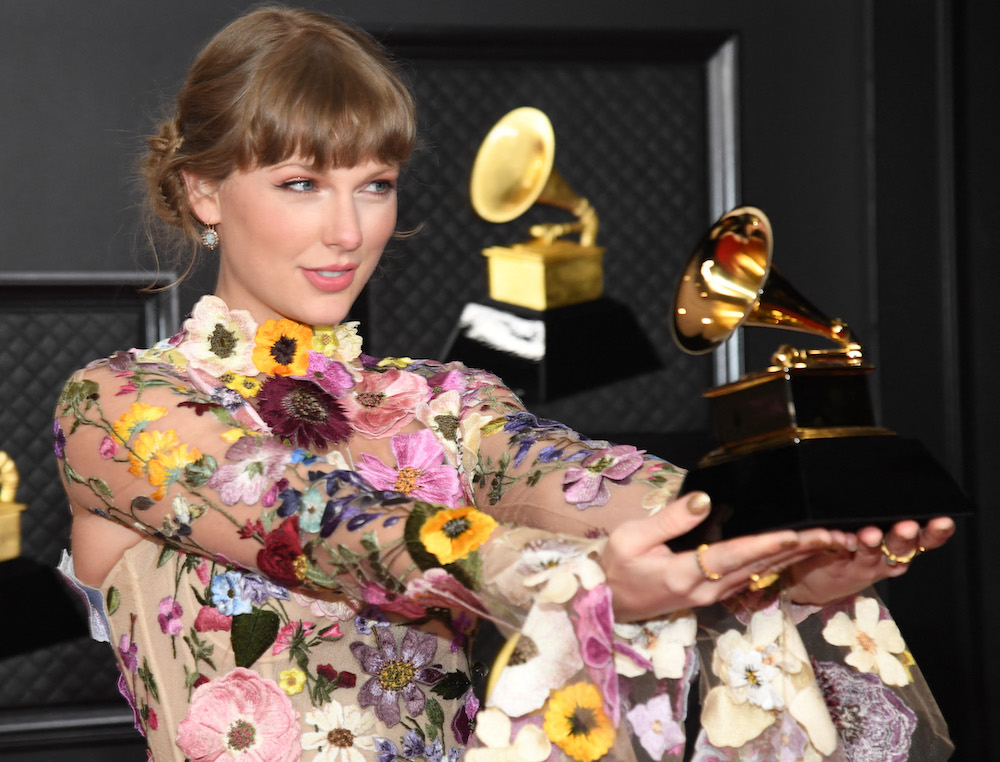 In this handout photo courtesy of The Recording Academy, Taylor Swift, winner of the Album of the Year award for 'Folklore,' poses in the media room during the 63rd Annual Grammy Awards in Los Angeles March 15, 2021. — Handout via AFP