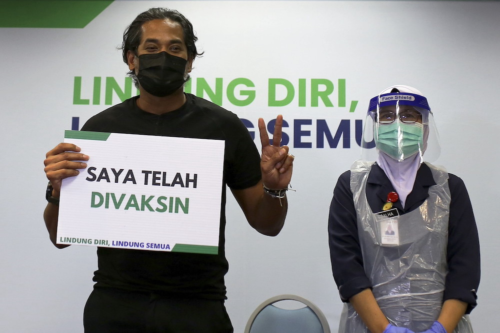 National Covid-19 Immunisation Programme Coordinating Minister Khairy Jamaluddin poses for the cameras after receiving the Sinovac Covid-19 vaccine at the Rembau Hospital, March 18, 2021. — Bernama pic