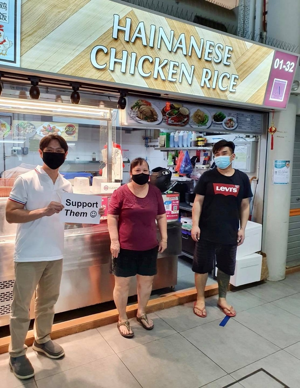 Singapore Member of Parliament Louis Ng holds a placard calling for support for local food businesses during a visit to Yishun Park Hawker Centre in Singapore, in this photo posted on Facebook June 20, 2020. — Picture from Facebook/Louis Ng via Reuters