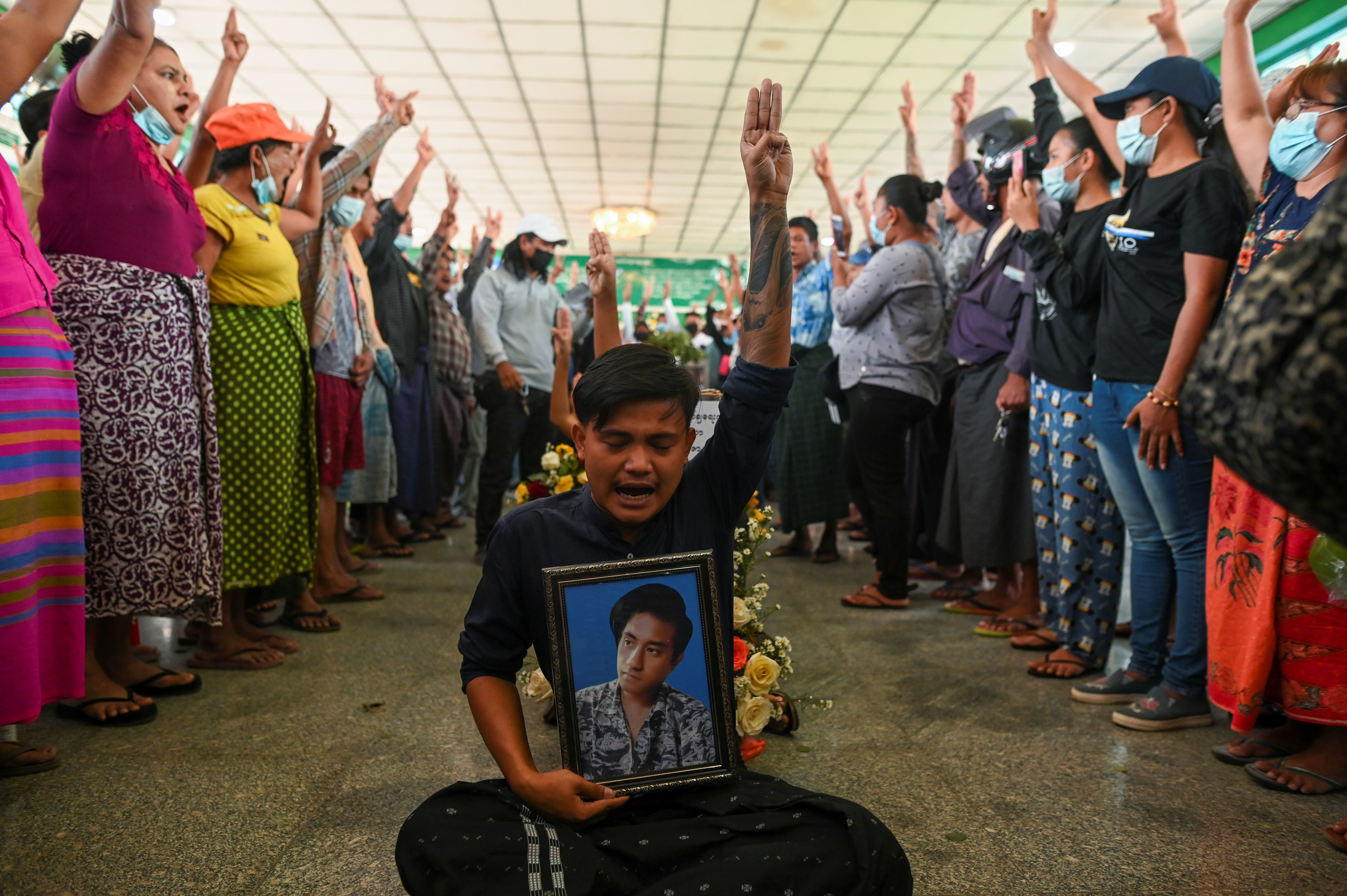 People flash a three-finger salute as they attend the funeral of victims shot dead during the anti-coup protest in Yangon, Myanmar March 5, 2021. ― Reuters pic