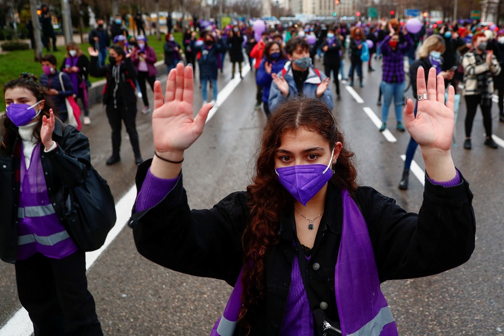 People take part in a demonstration to mark International Women's Day, despite of being banned by local authorities, in Madrid March 8, 2021. — Reuters pic