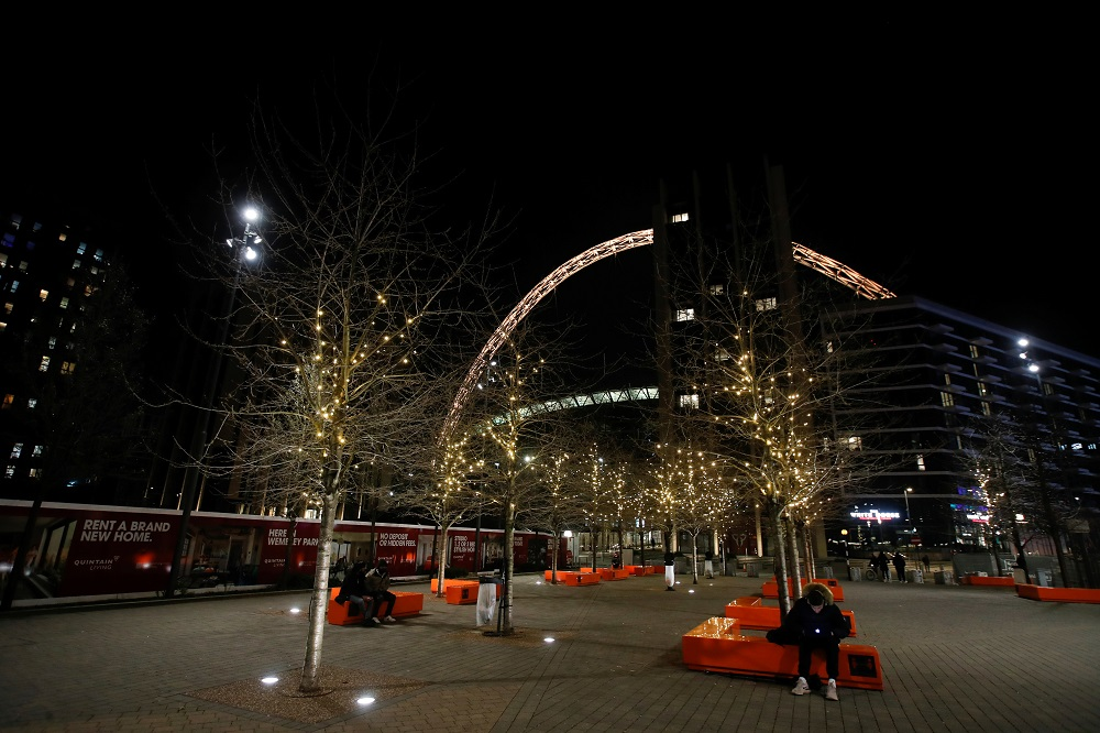 Wembley stadium is illuminated in yellow, as part of a day of reflection to mark the anniversary of Britain's first coronavirus disease lockdown, in London March 23, 2021. — Reuters pic