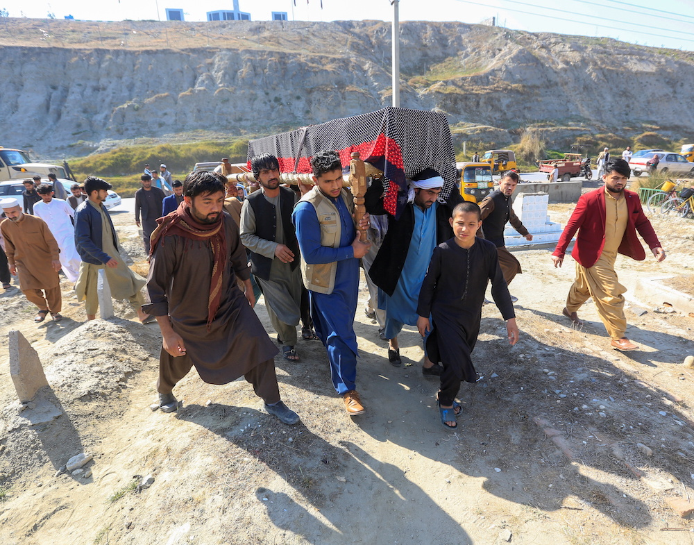 Afghan men carry the coffin of one of three female media workers who were shot and killed by unknown gunmen, in Jalalabad, Afghanistan March 3, 2021. — Reuters pic