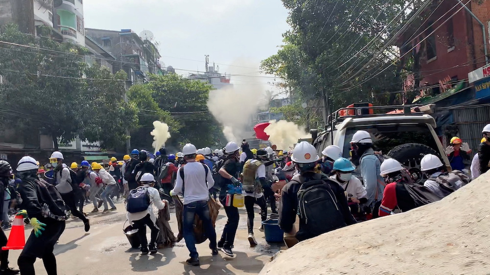 Protesters set off smoke grenades to block the view from snipers in Sanchaung, Yangon, Myanmar March 3, 2021, in this still image from a video obtained by Reuters. — Reuters pic
