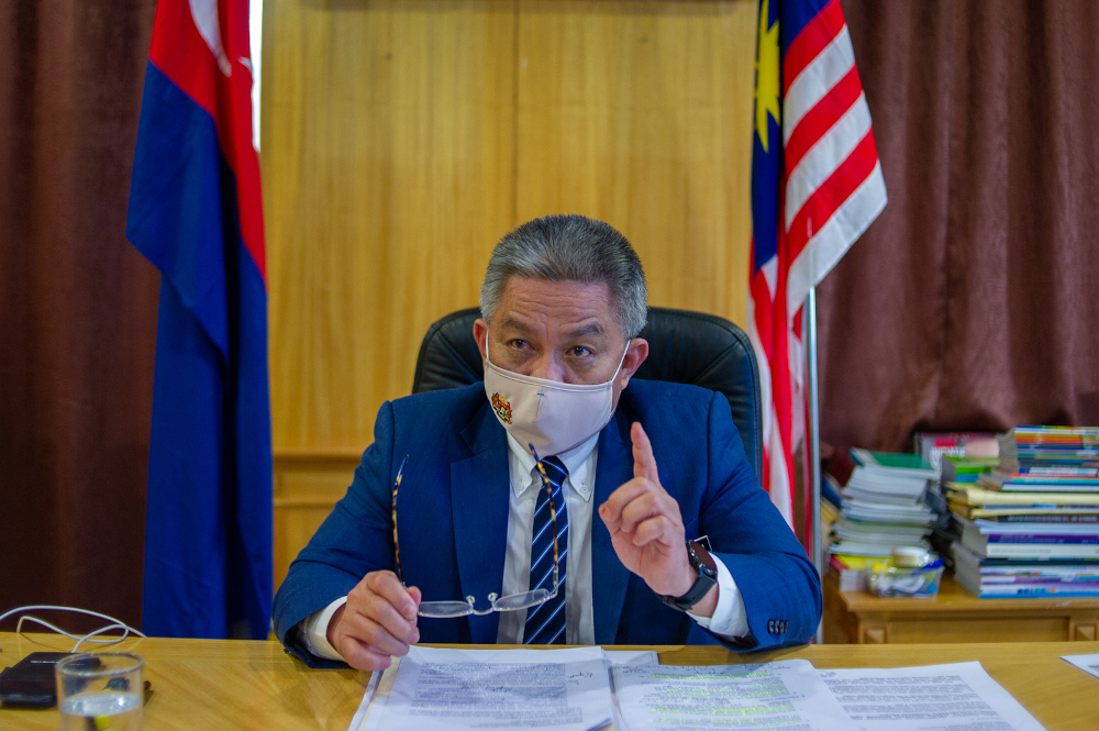 Health minister Datuk Seri Dr Adham Baba said his ministry will make the recommendation to the government, but added that it will not be a blanket reopening of state borders compared to last year, to prevent triggering another spike in infection cases. — Picture by Shafwan Zaidon