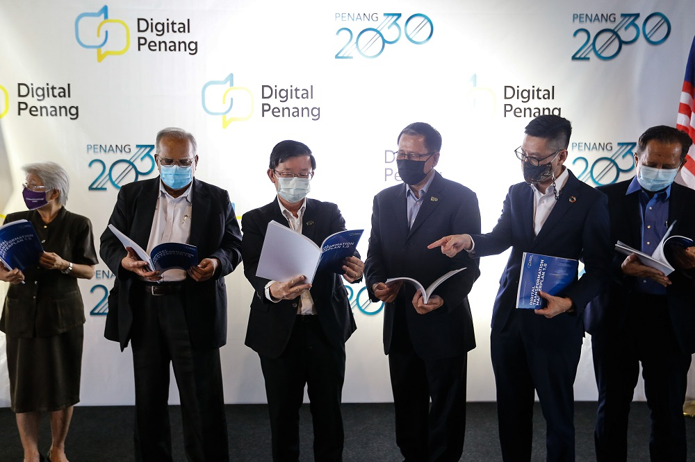 Penang Chief Minister Chow Kon Yeow (centre) with a copy of the Digital Transformation Master Plan booklet during a group photo following the launch of Digital Penang at Wisma Yeap Chor Ee in George Town March 12, 2021. — Picture by Sayuti Zainudin