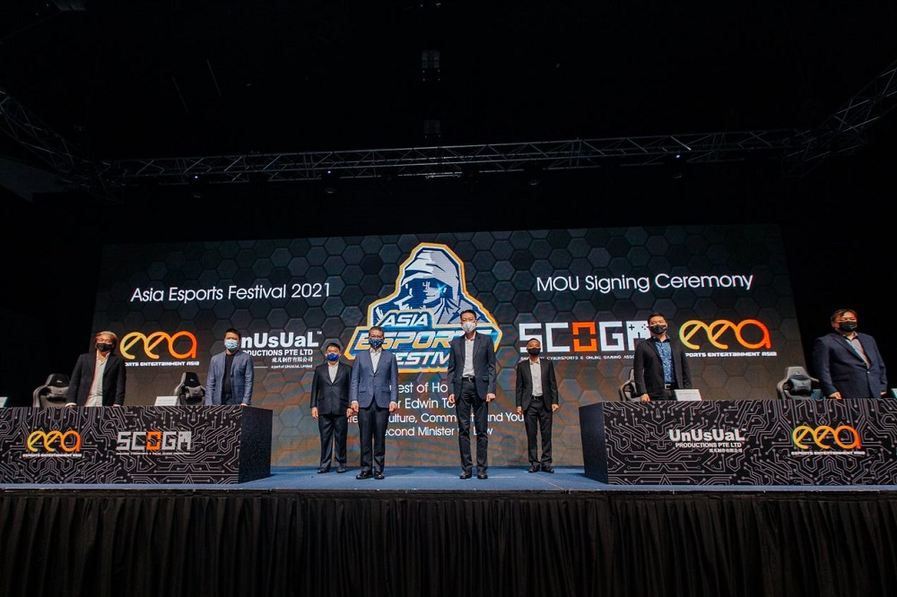 (Front, from left) Ong, UnUsUaL Productions director of sales and pperations, Alan Meng together with (back, from left) Back EEA Advisory Board chairman, Nicholas Khoo and Greenwillow Capital Management's managing director BG Loh Wai Keong. — Picture courtesy of Esports Entertainment Asia Pte Ltd
