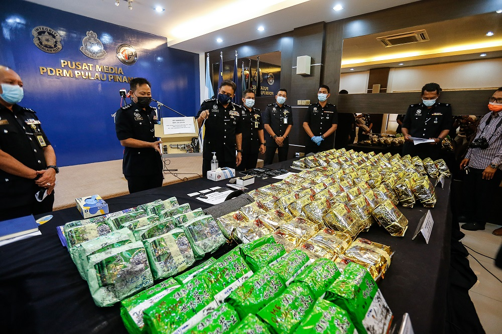 Penang police chief Datuk Sahabudin Abd Manan (third left) shows some of the items confiscated during the raid, at a press conference in George Town February 22, 2021. —  Pictures by Sayuti Zainudin
