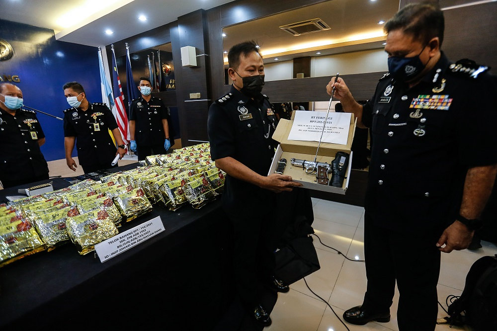 Penang police chief Datuk Sahabudin Abd Manan (right) during a press conference in George Town February 22, 2021.