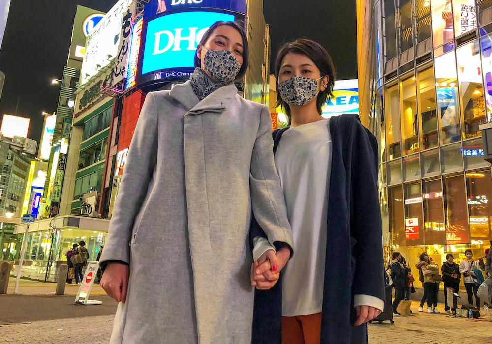 Lesbian couple Jenny and Narumi pose at Shibuya crossing in Tokyo, Japan, March 19, 2021. — Reuters pic