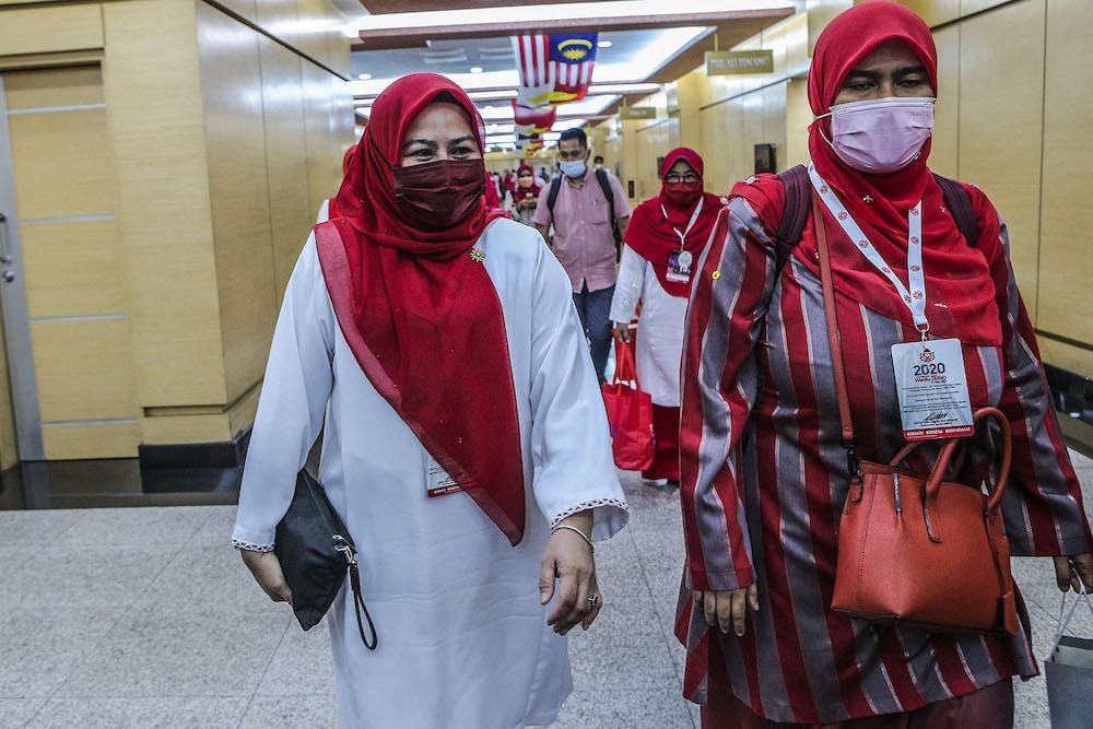 Wanita Umno chief, Datuk Seri Noraini Ahmad (left) is pictured at the 2020 Umno annual general meeting in Kuala Lumpur March 27, 2021. —  Photo by Hari Anggara.