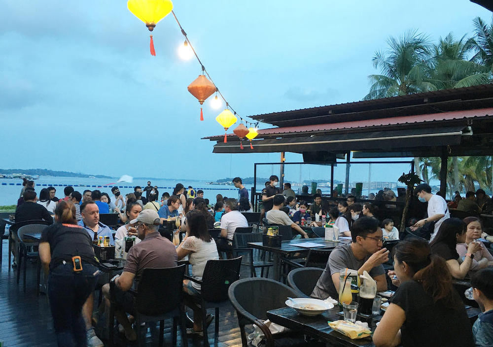 People having dinner at a restaurant in Pasir Ris Park, Singapore. — TODAY pic