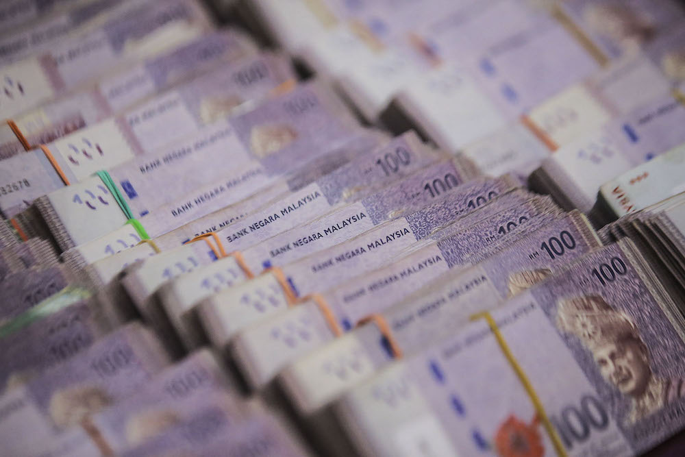 The ringgit closed lower against the greenback today in tandem with the equities market's fall on lack of risk appetite. ― Picture by Hari Anggara