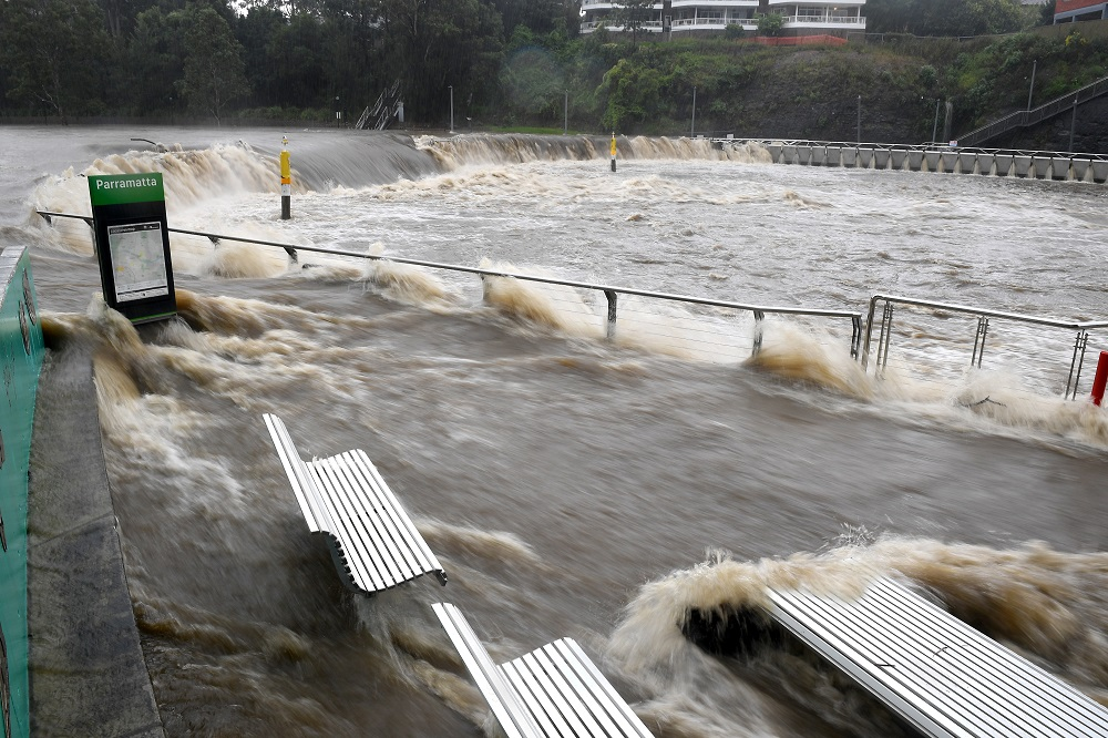 The swollen Parramatta River is seen overflowing as the state of New South Wales experiences heavy rains, in Sydney March 20, 2021. ― Handout via Reuters