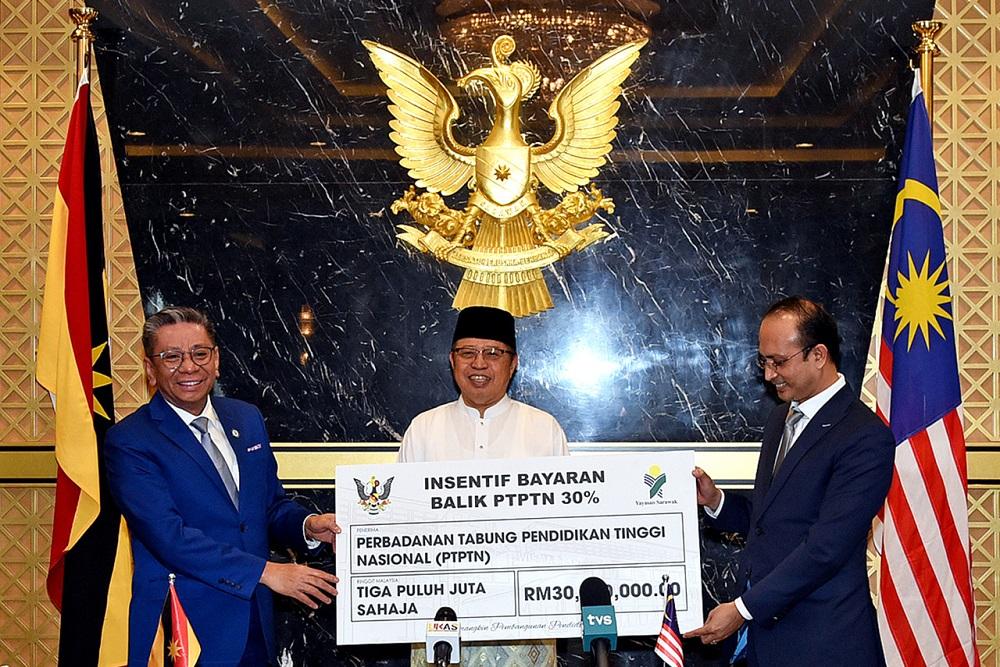 Sarawak Chief Minister Datuk Patinggi Abang Johari Openg (centre) during the Mou exchange between Yayasan Sarawak and PTPTN at his office in Petra Jaya March 5, 2021. — Bernama pic