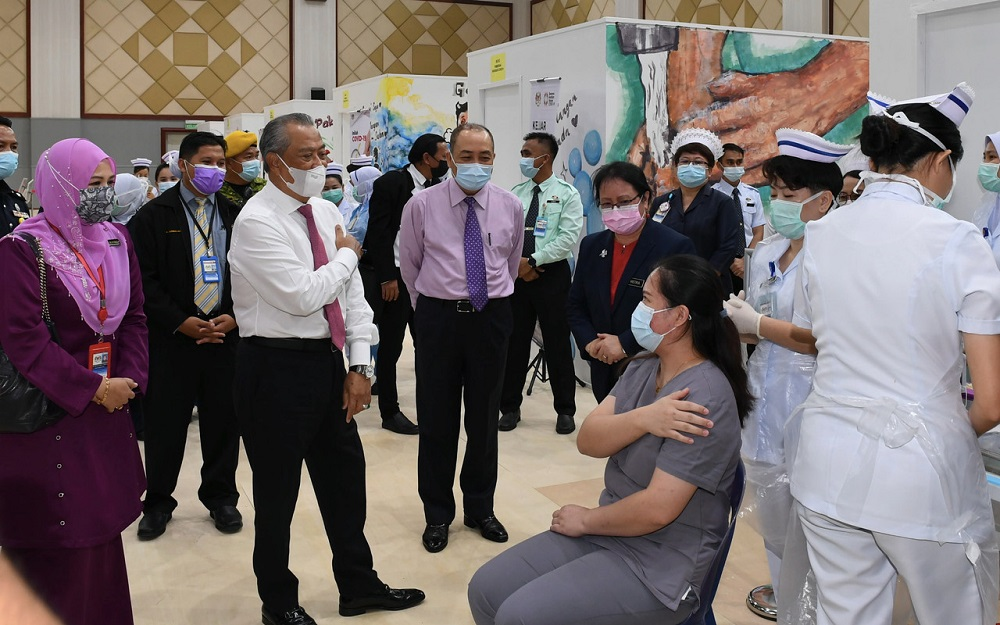 File picture shows Prime Minister Tan Sri Muhyiddin Yassin (third left) during a visit to a Covid-19 vaccination centre in Kota Kinabalu, Sabah, March 22, 2021. — Bernama pic