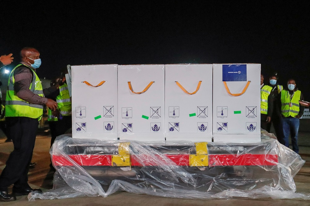 Kenyan health and customs workers receive the first batch of AstraZeneca/Oxford vaccines under the Covax scheme at the Jomo Kenyatta international airport in Nairobi, Kenya March 3, 2021. ― Reuters pic