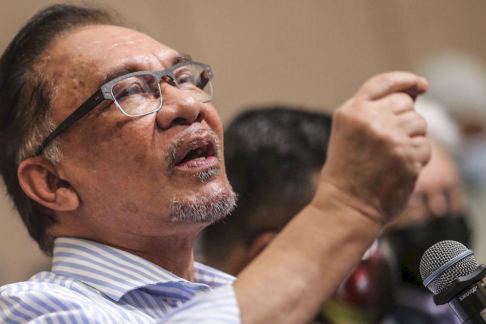 PKR president Datuk Seri Anwar Ibrahim speaking during a press conference at Eastin Hotel in Petaling Jaya, March 16, 2021. ― Picture by Hari Anggara