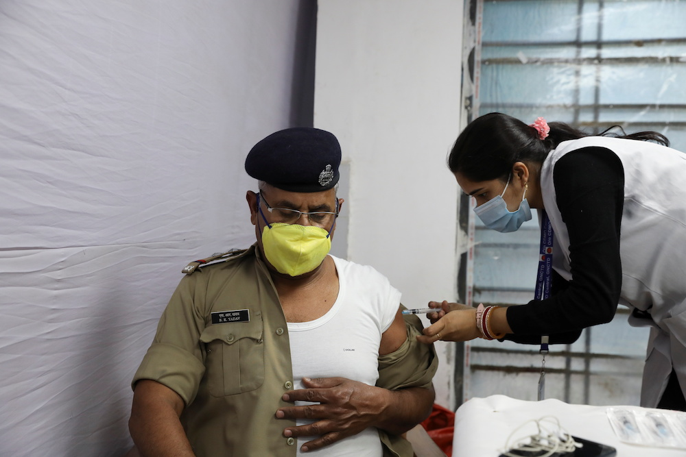 A Central Industrial Security Force officer receives a dose of Bharat Biotech's coronavirus disease vaccine, called COVAXIN, at a vaccination centre in New Delhi, India, March 5, 2021. — Reuters pic