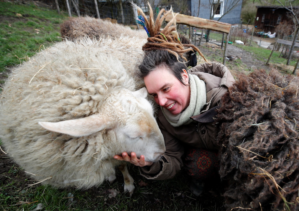 Lexa Voss, personality development coach, strokes her sheep Edda at her little farm, where she holds sheep cuddling seminars during Covid-19 lockdown in Hattingen, near Wuppertal, Germany, March 11, 2021. — Reuters pic
