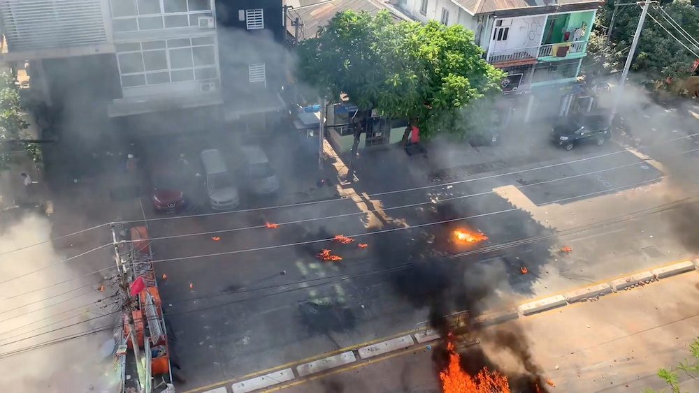 Smoke rise from burning objects during a protest in Yangon, Myanmar, March 4, 2021, in this still image taken from a video obtained by Reuters. — Reuters pic