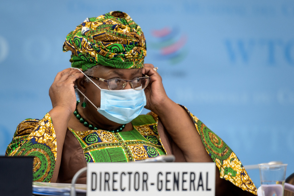 New WTO director-general Ngozi Okonjo-Iweala adjustes her face mask as a preventive measure against the Covid-19 coronavirus during a session of the WTO General Council upon her arrival at the WTO headquarters to takes office March 1, 2021 in Geneva. — AFP pic