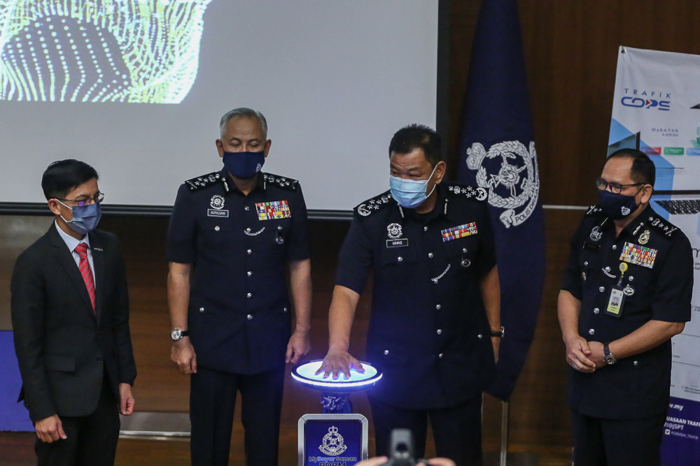 Inspector-General of Police Tan Sri Abdul Hamid Bador officiating the launch of MyBayar Saman app and online portal at the Bukit Aman headquarters in Kuala Lumpur March 25, 2021. — Picture by Yusof Mat Isa