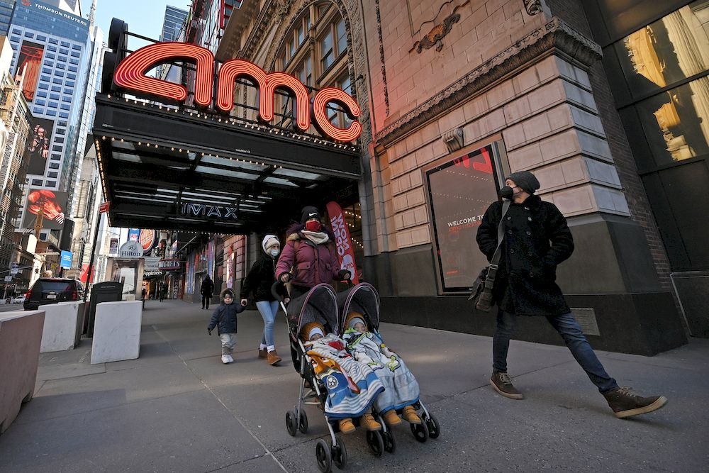 People walk past the AMC 42nd Street theatre in New York March 5, 2021. — Reuters pic