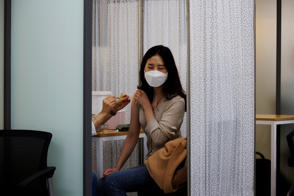A health worker gets a dose of the Pfizer-BioNTech coronavirus disease vaccine at a Covid-19 vaccination centre in Seoul, South Korea, March 10, 2021. — Reuters pic